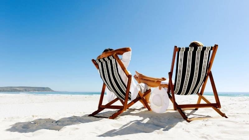 Financial Independence Retire Early Hero Image Of two people on a beach | BeTheBudget