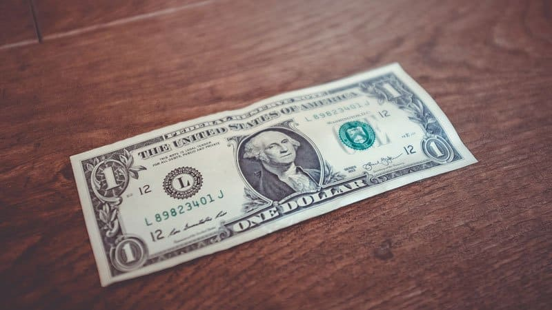 Dollar bill to symbolize paying in cash | BeTheBudget