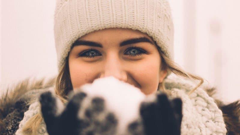 girl holding snowball   BeTheBudget