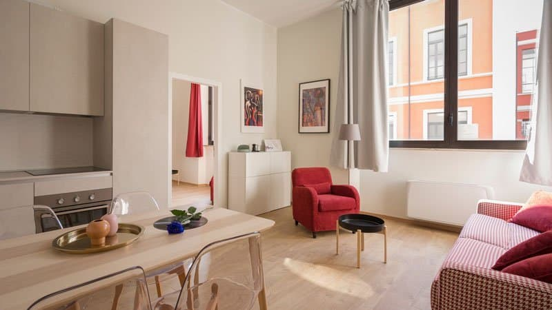apartment with wood floors and red accents | apartment checklist